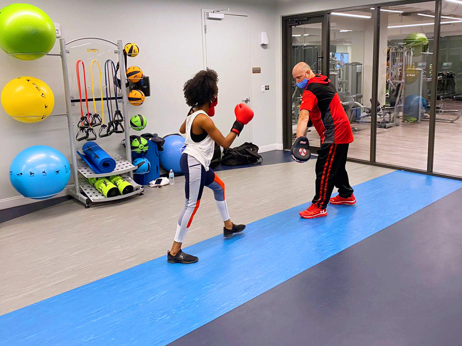 professor and student practicing kickboxing at sanctuary doral