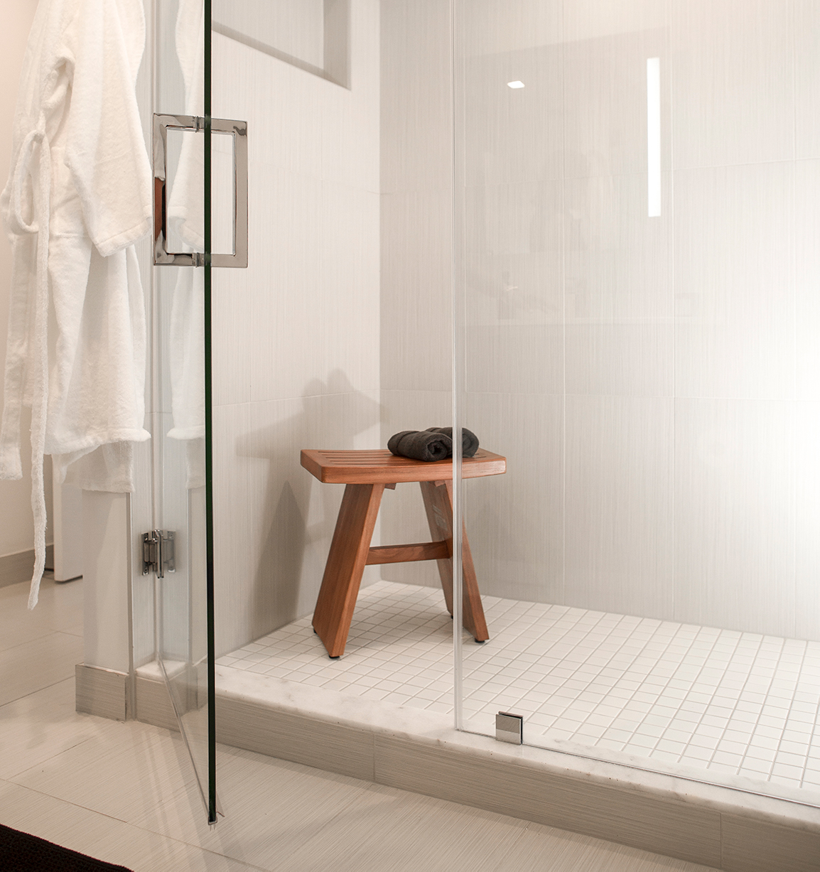 shower and chair white walls