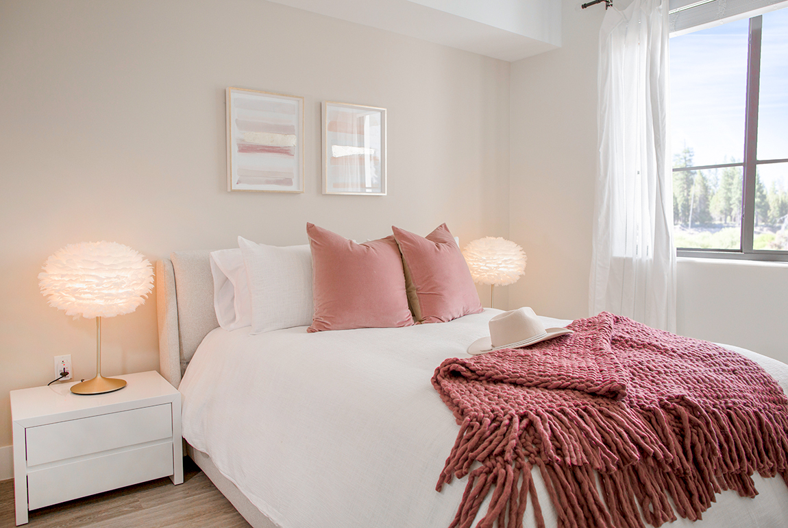 bedroom with red pillows and blanket