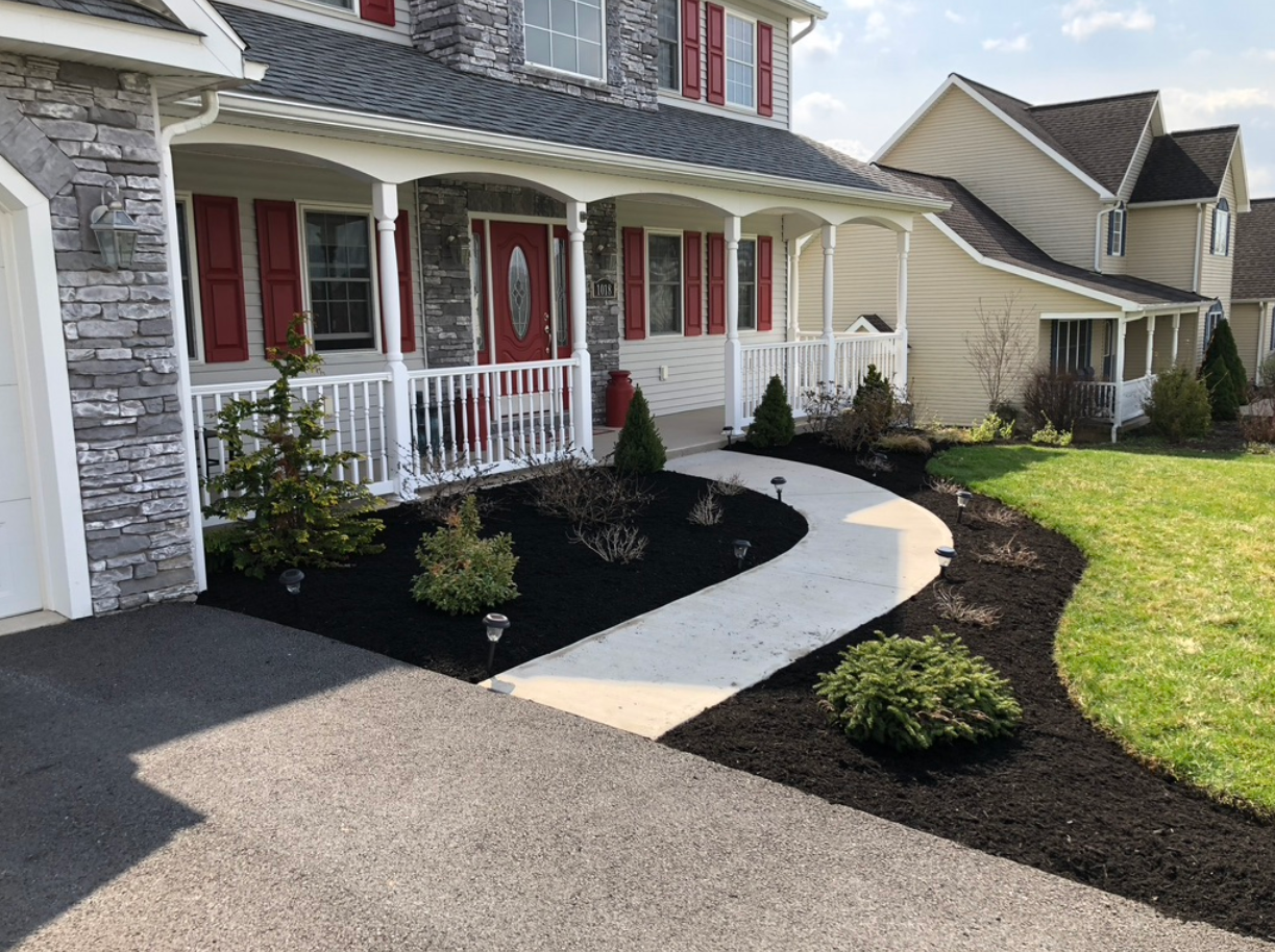 a finished mulch and weeding job by jc landscapes llc