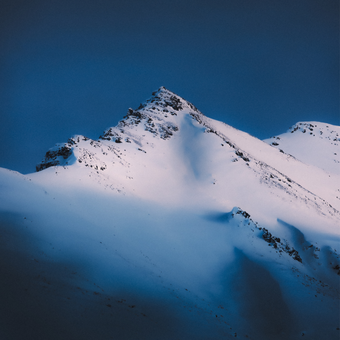 a snow covered mountains with shadows