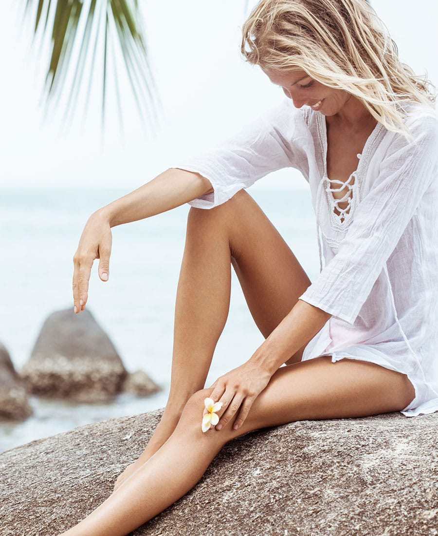 client on the beach after laser hair removal in Salt Lake City and Cottonwood Heights