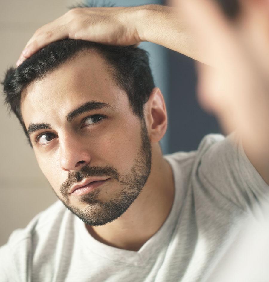client after hair restoration in Salt Lake City