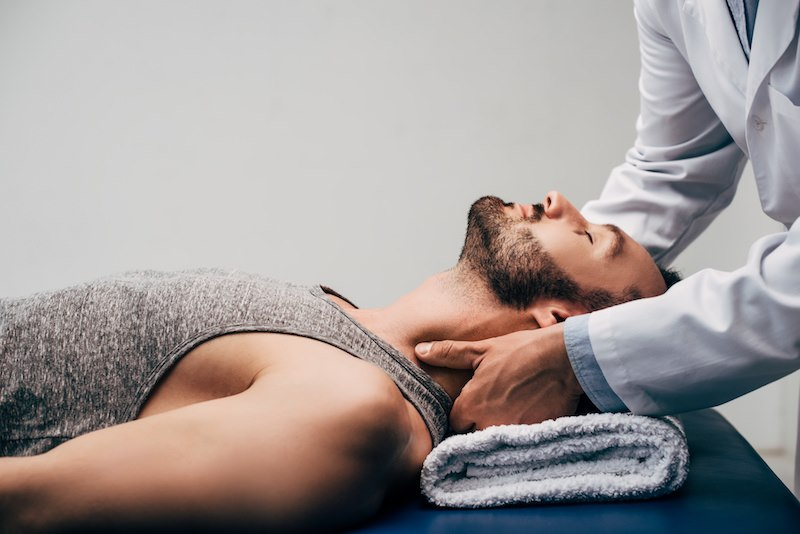 therapist giving treatment to the neck