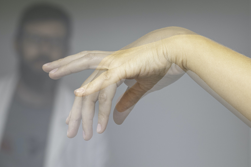person shaking their hands to relieve numbness from carpal tunnel syndrome