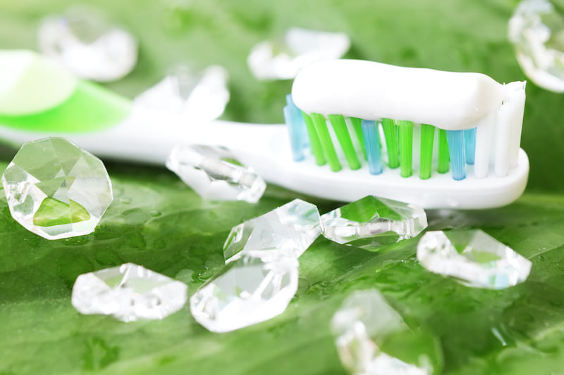 Toothbrush with toothpaste and crystals