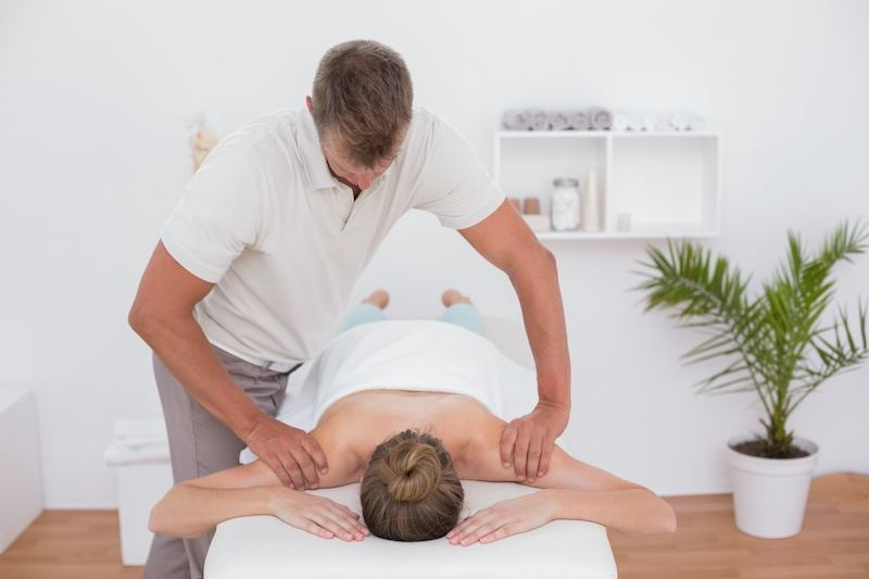 Physiotherapist providing treatment in a private room