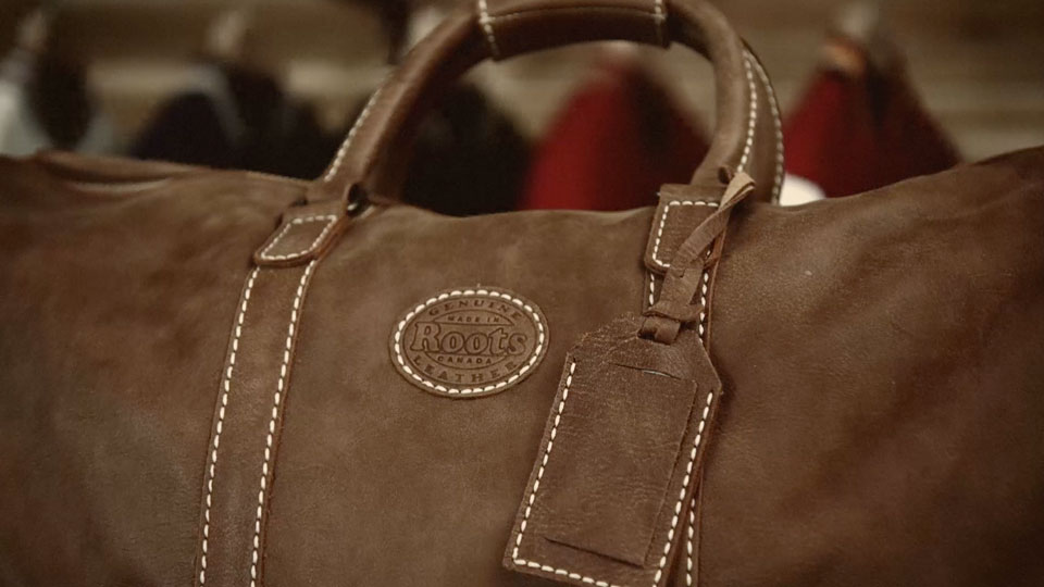 Roots Leather bag with a close-up of the handle