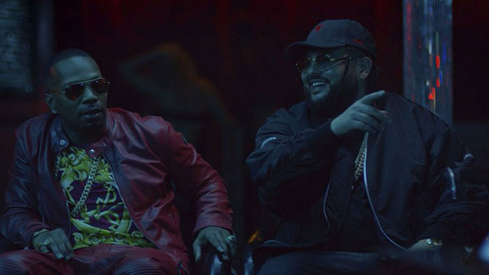 Belly and Juicy J sitting at night under cool, dark lighting having a conversation