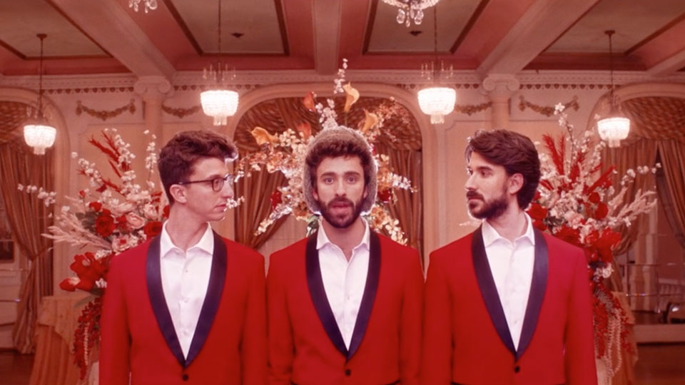 Band dressed in red sport coats and white dress shirts in a casino