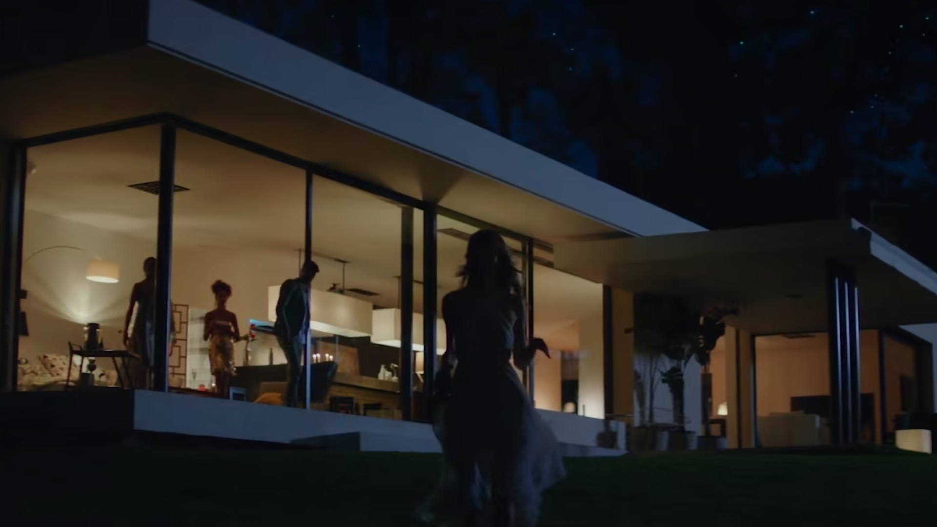 People in a house at night