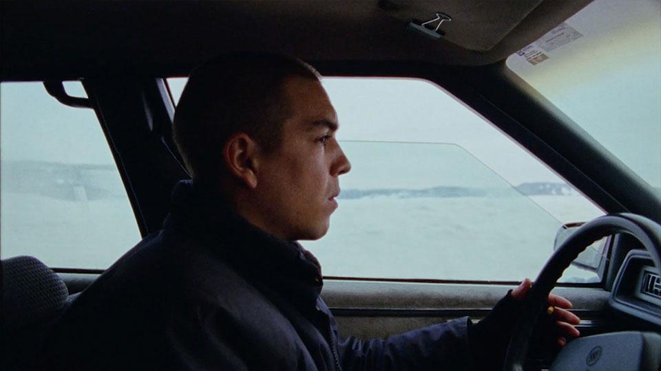 Man sitting in car driving.