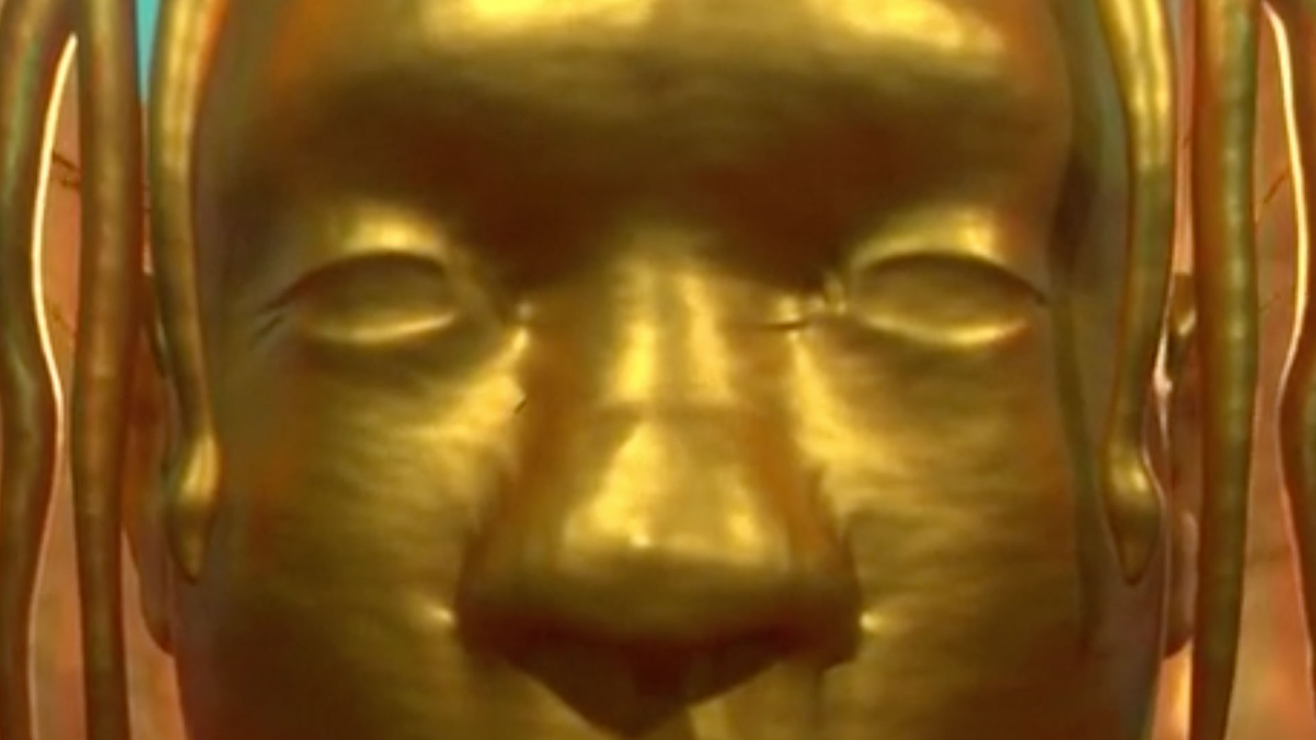 Close up of golden statue's eyes.