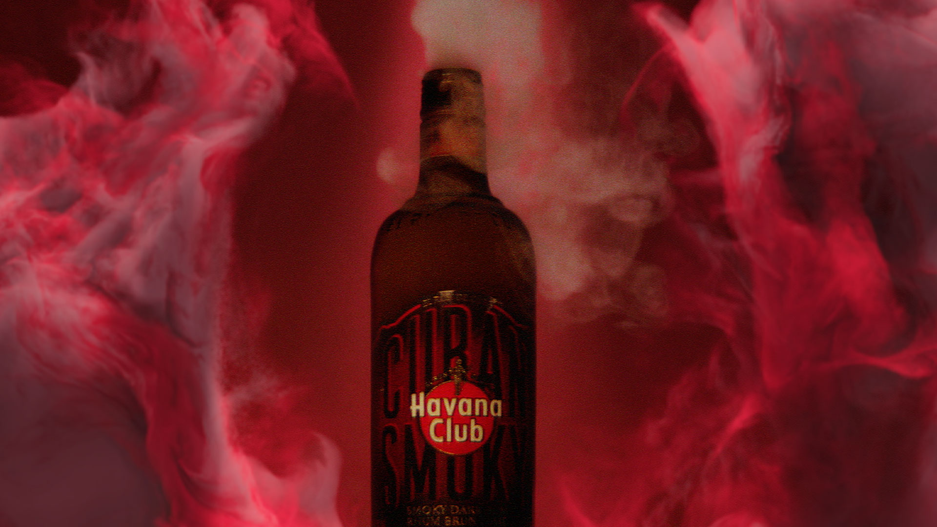 Havana Club Cuban Smoky bottle surrounded by red smoke.