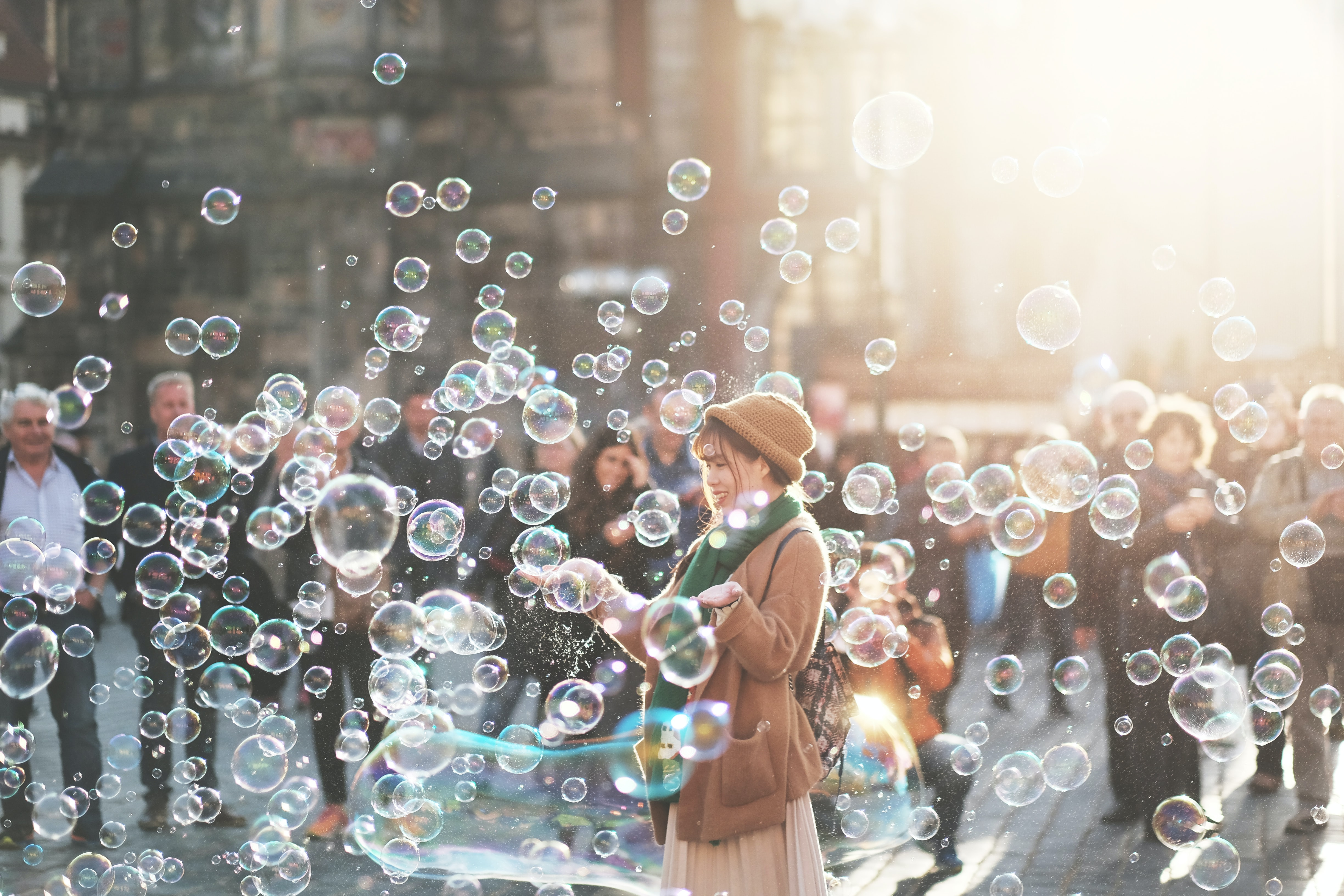 Girl with bubbles in a city