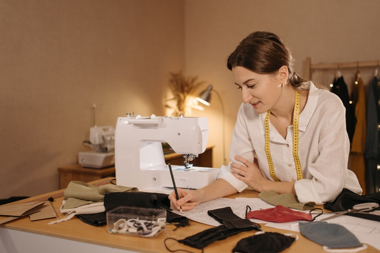a woman with a sewing machine manufacturing a product