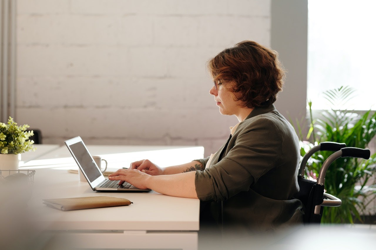 a woman working on her blog
