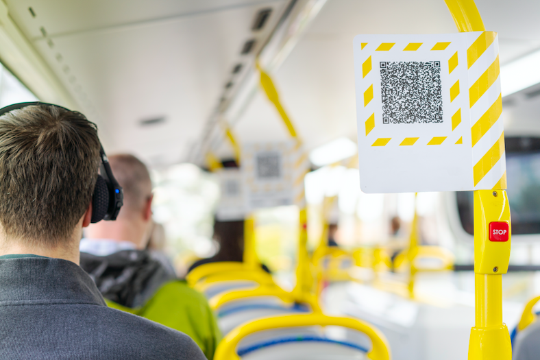 A printed QR code on a bus