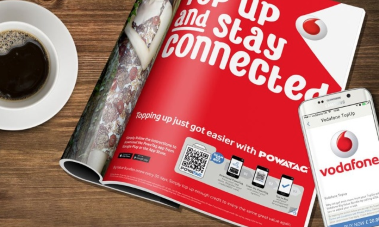 An advertisement in the magazine with a Vodafone top-up QR code