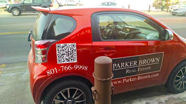 a qr code on a real estate car