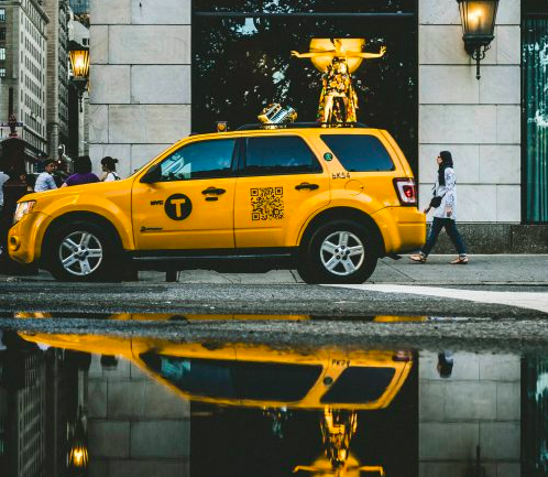 qr code sticker on a yellow new york taxi