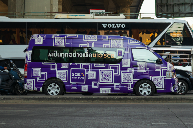a purple van covered in many white qr codes
