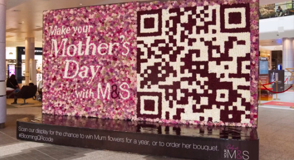 mother's day display with qr code made from flowers