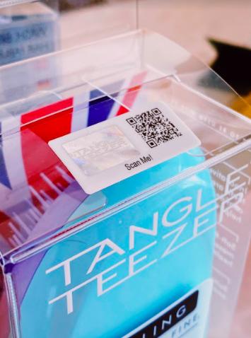 qr code on tangle teezer hair brush packaging