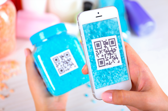 mobile phone scanning a qr code on a blue beauty product packaging