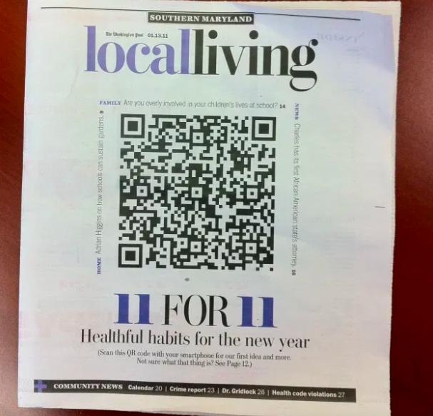 a huge qr code on a newspaper cover
