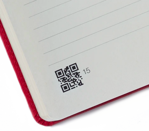 black and white qr code on a notebook's page