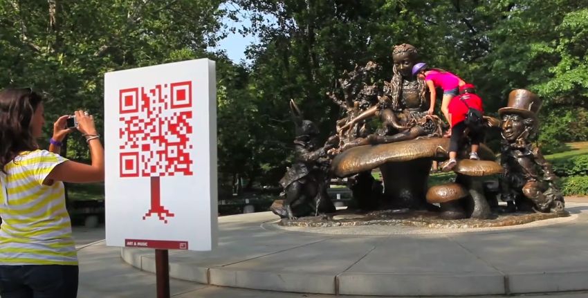 QR code poster by the Alice in Wonderland landmark in Central Park