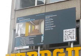 A big qr code billboard on the building