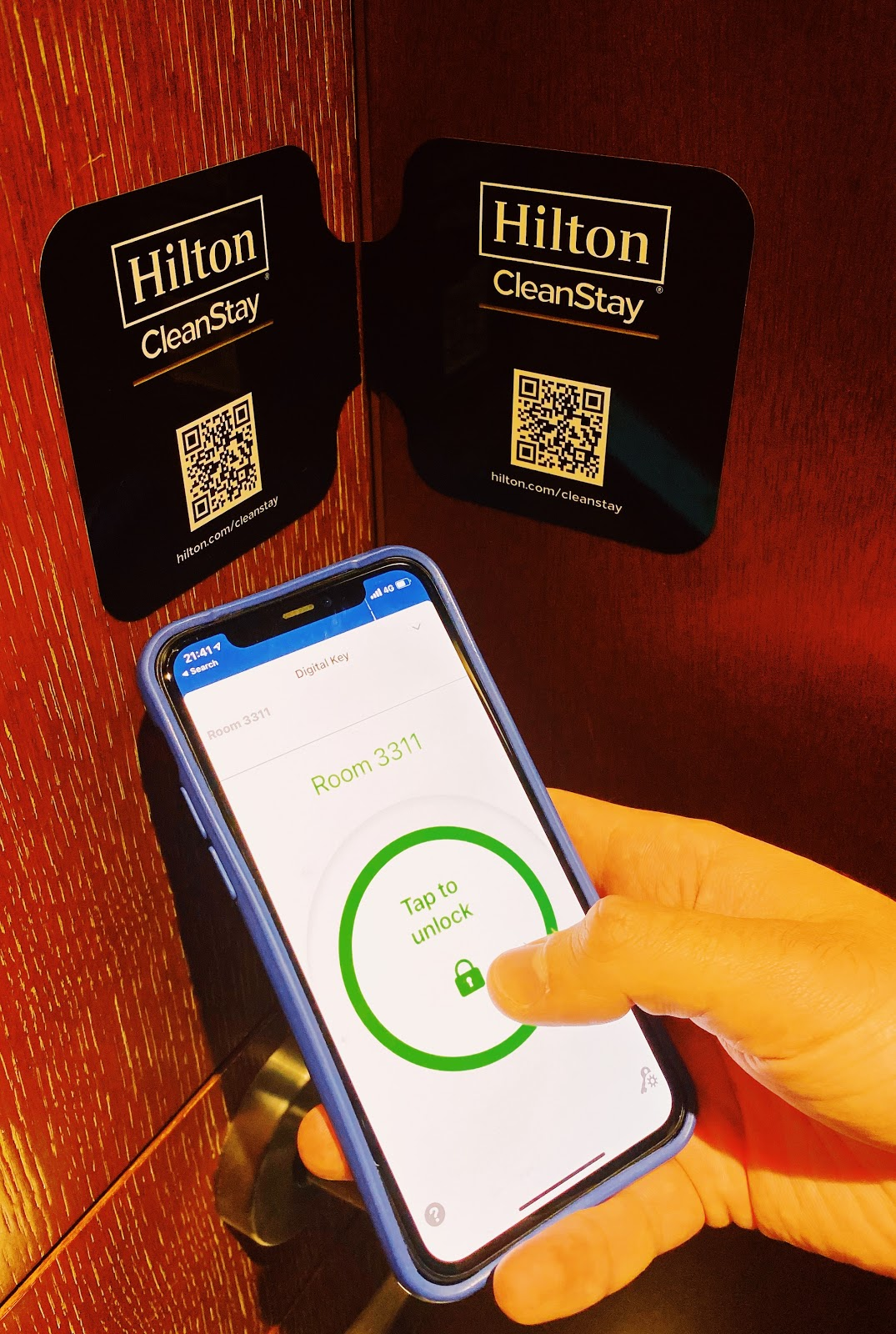 A phone opening a room with a QR code key at Stay Clean Hilton Hotel