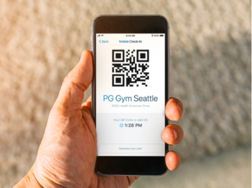 hand holding mobile phone with QR code gym check-in app