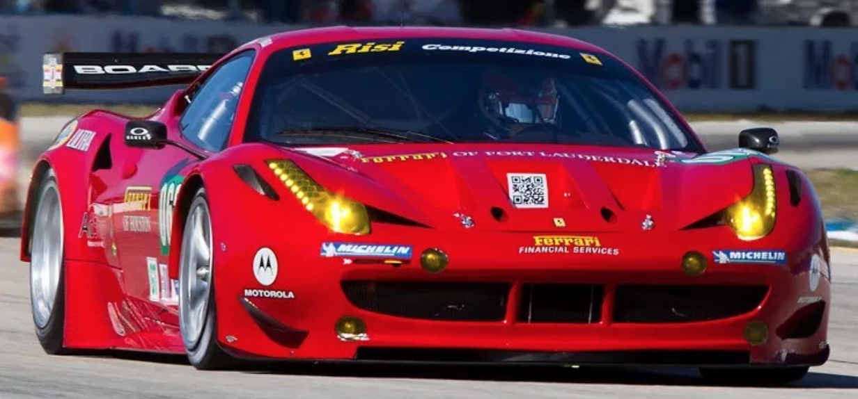 red ferrari with QR code on hood on a race track