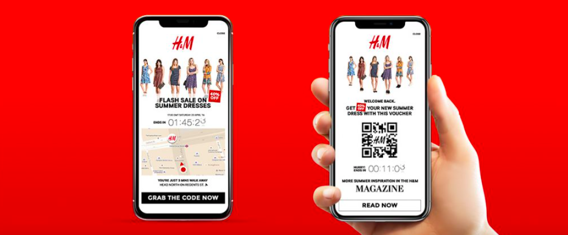 hand holding phone with QR code for H&M app