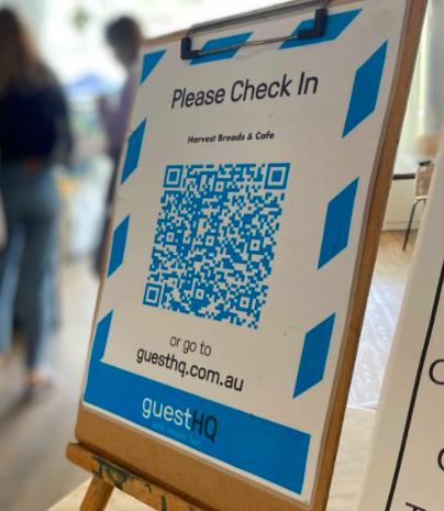 QR code trade show check-in on easel