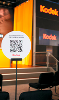 Kodak trade show QR codes displayed in the conference room