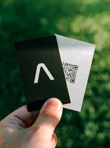 hand holding QR code business cards