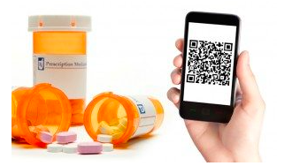 hand holding a mobile phone with a qr code and medicine bottles