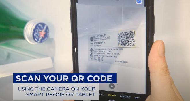 mobile phone scanning qr code label inside a refrigerator