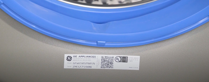 GE washer door frame with a QR code label on it
