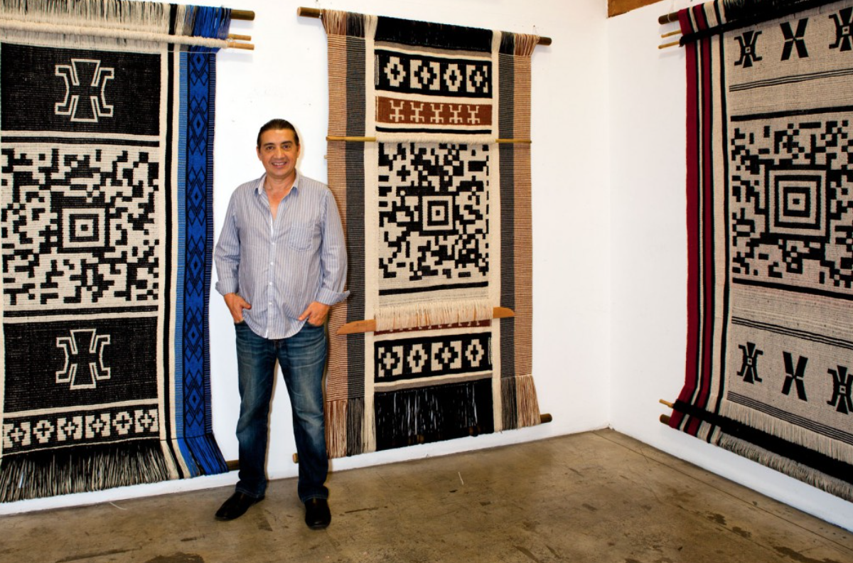 Guillermo Bert at a show of his encoded textiles at the Pasadena Museum of California Art