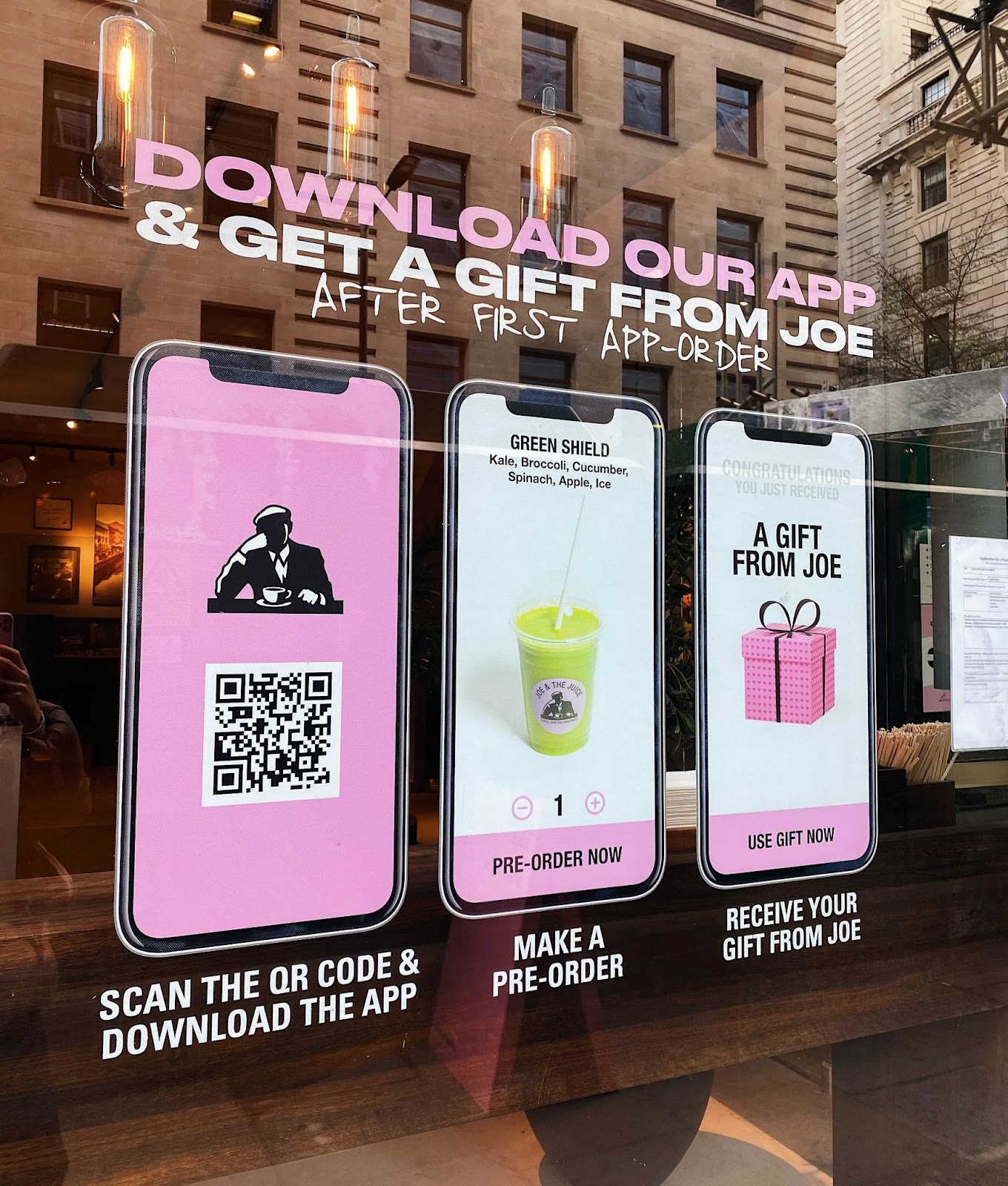 QR codes for apps in shop windows pink display