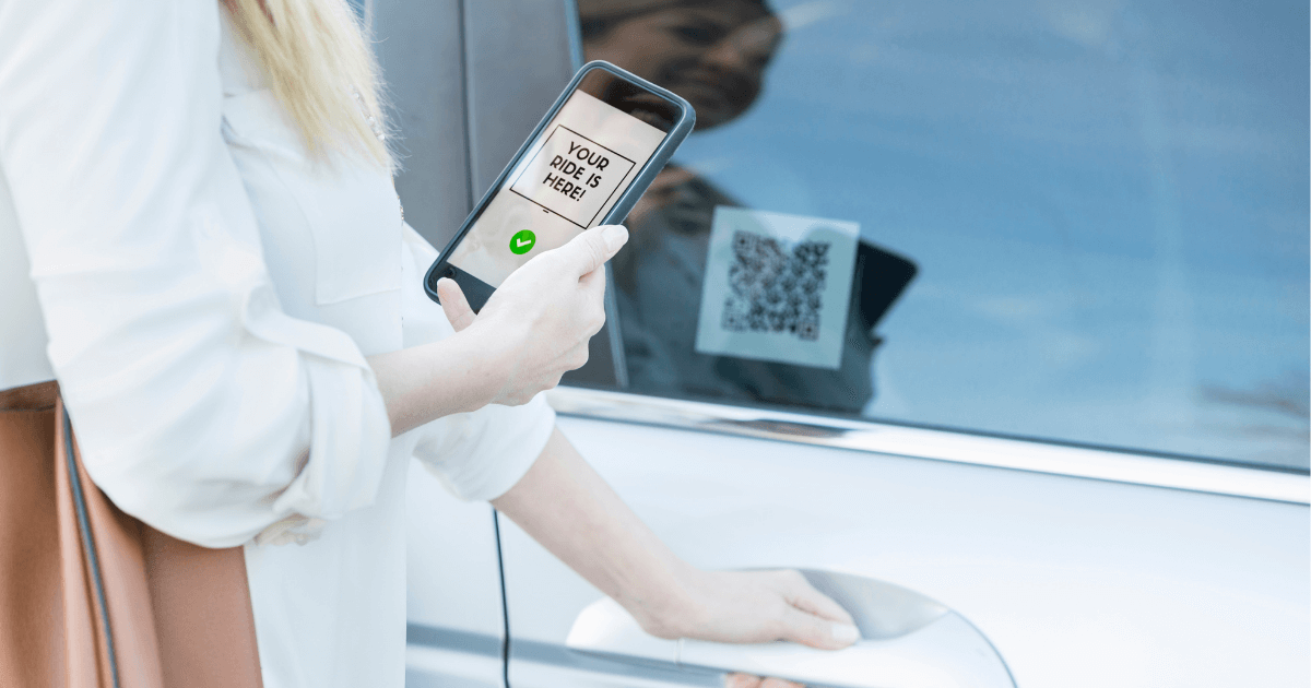 woman scanning a qr code for a taxi