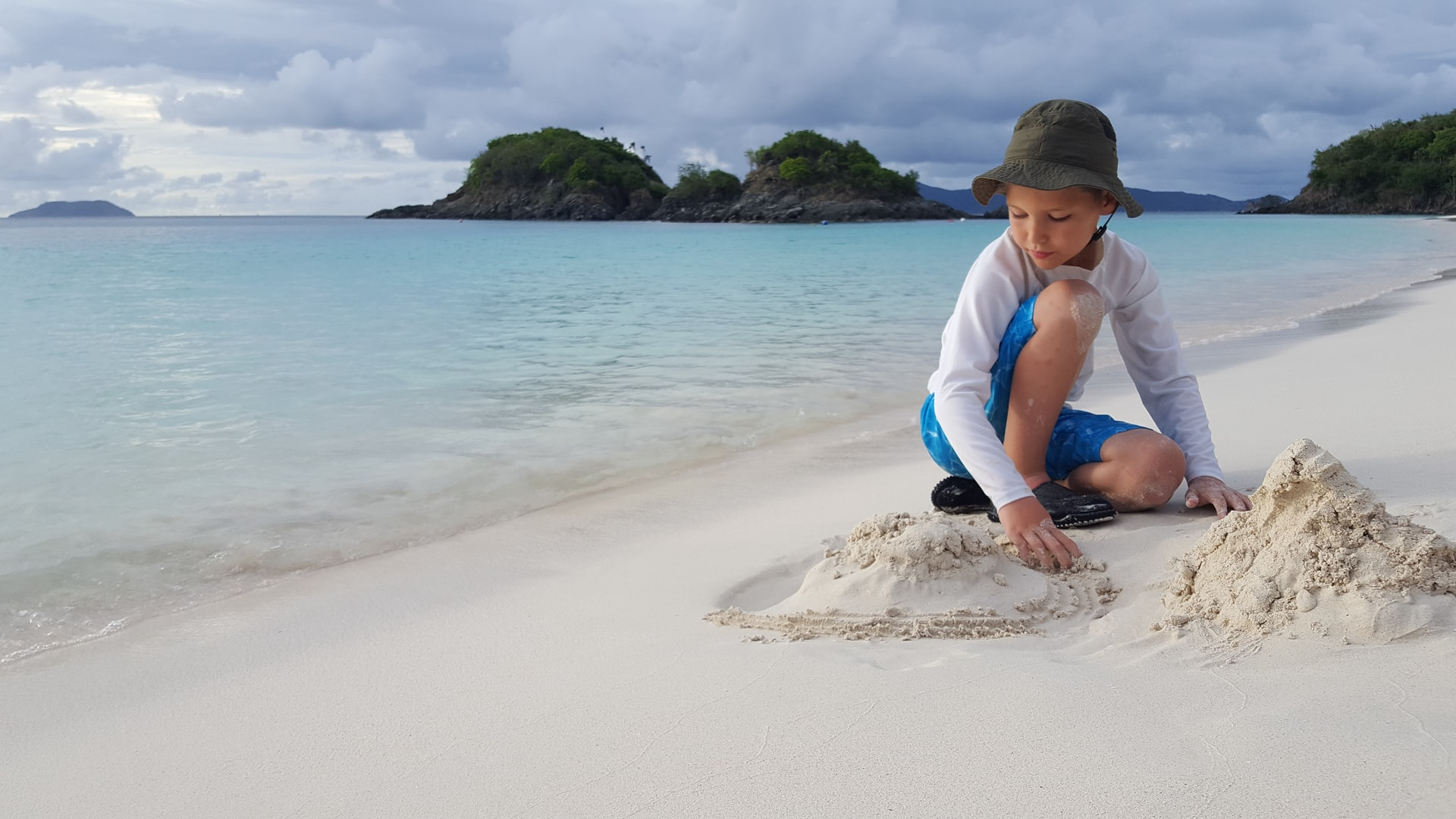 child playing on tropical beach