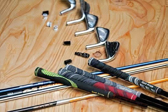 Golf clubs laying on the floor