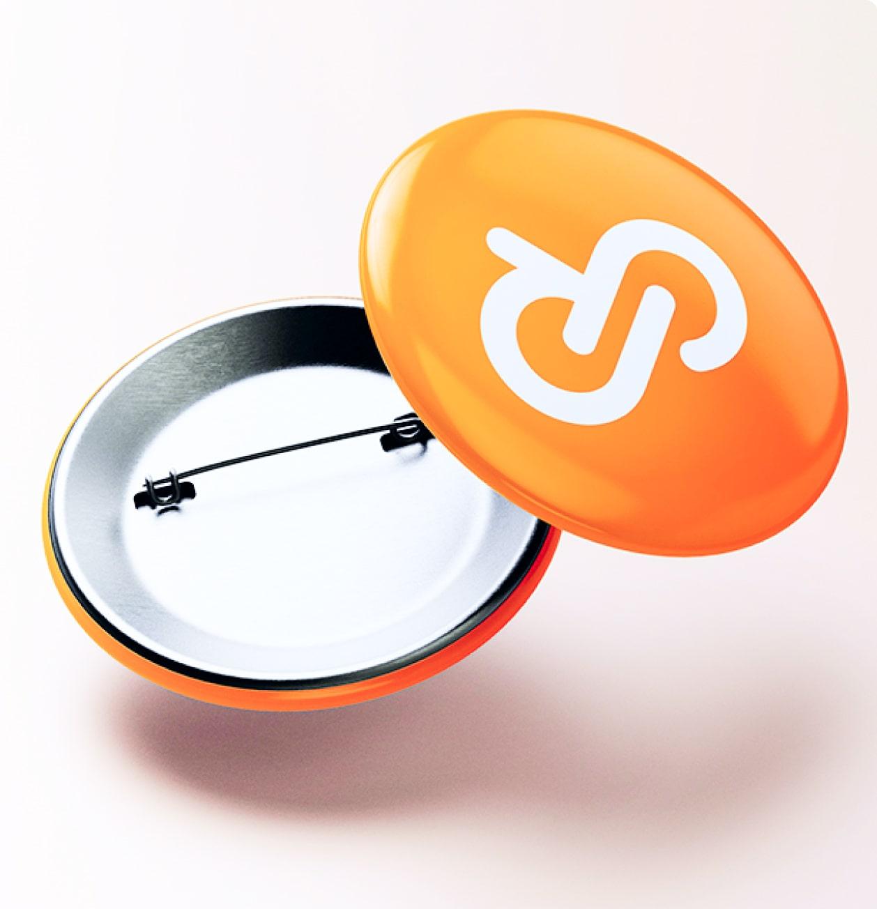 Entirebody logo on a pin