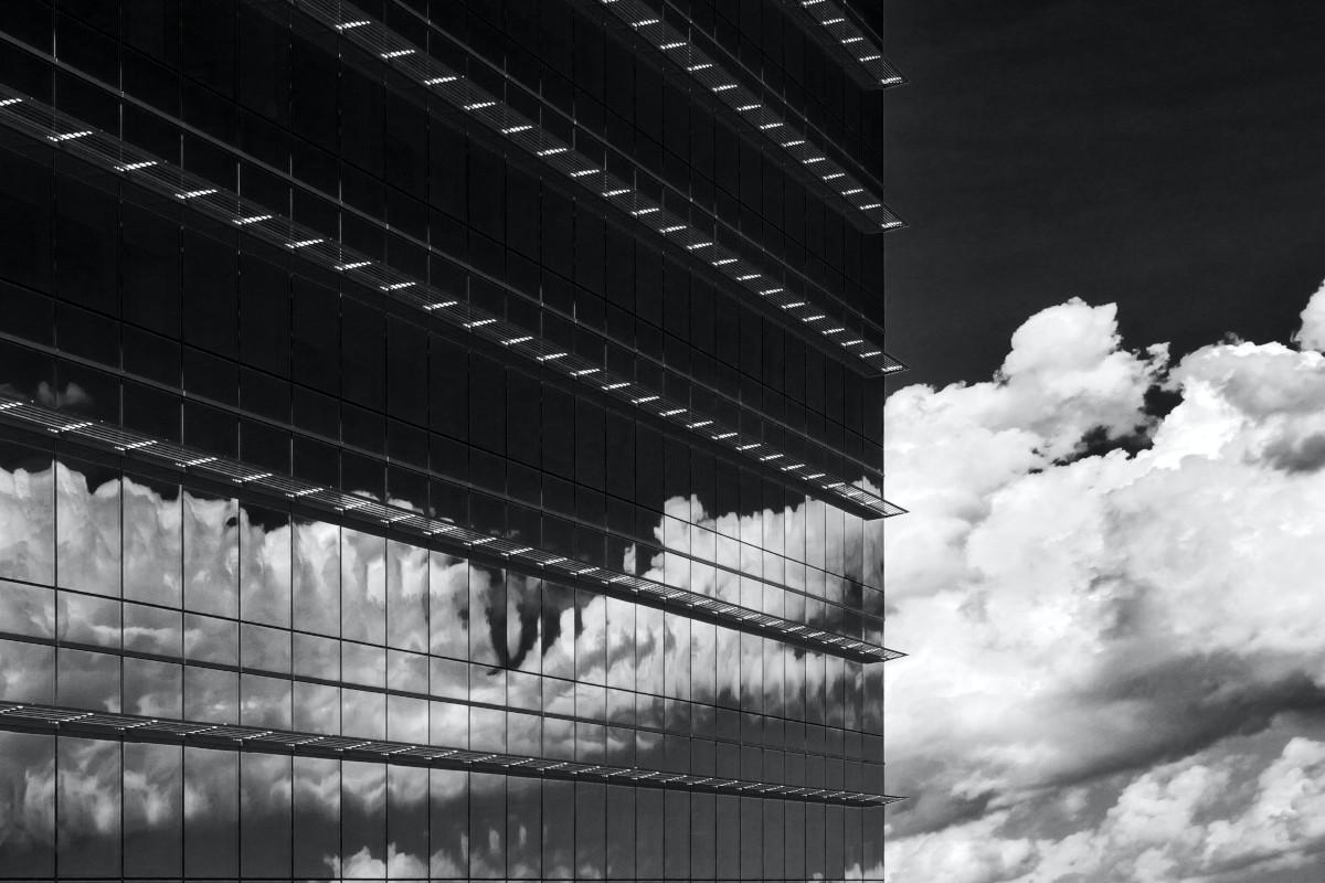 Clouds reflecting off a skyscraper